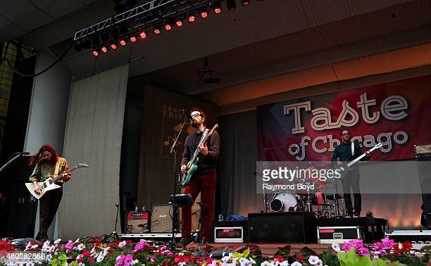 Musicians Brian Bell Rivers Cuomo Patrick Wilson and Scott Shriner from Weezer performs at the Petrillo Music Shell during the 35th Annual 'Taste Of...