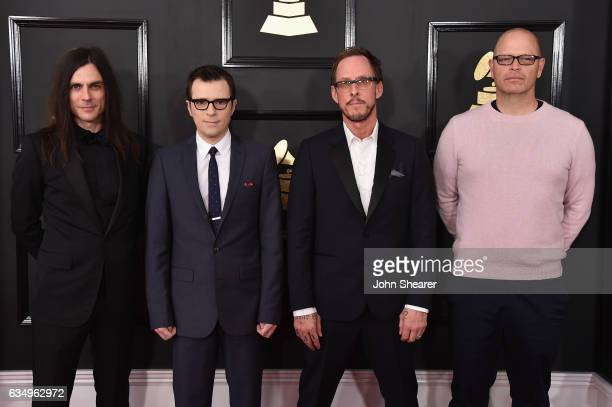 Musicians Brian Bell Rivers Cuomo Scott Shriner and Patrick Wilson of Weezer attend The 59th GRAMMY Awards at STAPLES Center on February 12 2017 in...