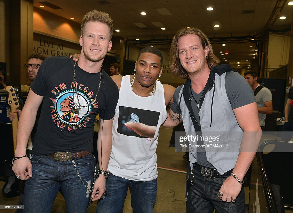 Musicians Brian Kelley (L) and Tyler Hubbard (R) of Florida Georgia Line and recording artist <a gi-track='captionPersonalityLinkClicked' href=/galleries/search?phrase=Nelly+-+Rapper&family=editorial&specificpeople=11499081 ng-click='$event.stopPropagation()'>Nelly</a> attend Tim McGraw's Superstar Summer Night presented by the Academy of Country Music at the MGM Grand Garden Arena on April 8, 2013 in Las Vegas, Nevada.