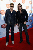Musicians Brian Kelley and Tyler Hubbard of Florida Georgia Line arrive at the American Country Awards 2013 at the Mandalay Bay Events Center on...