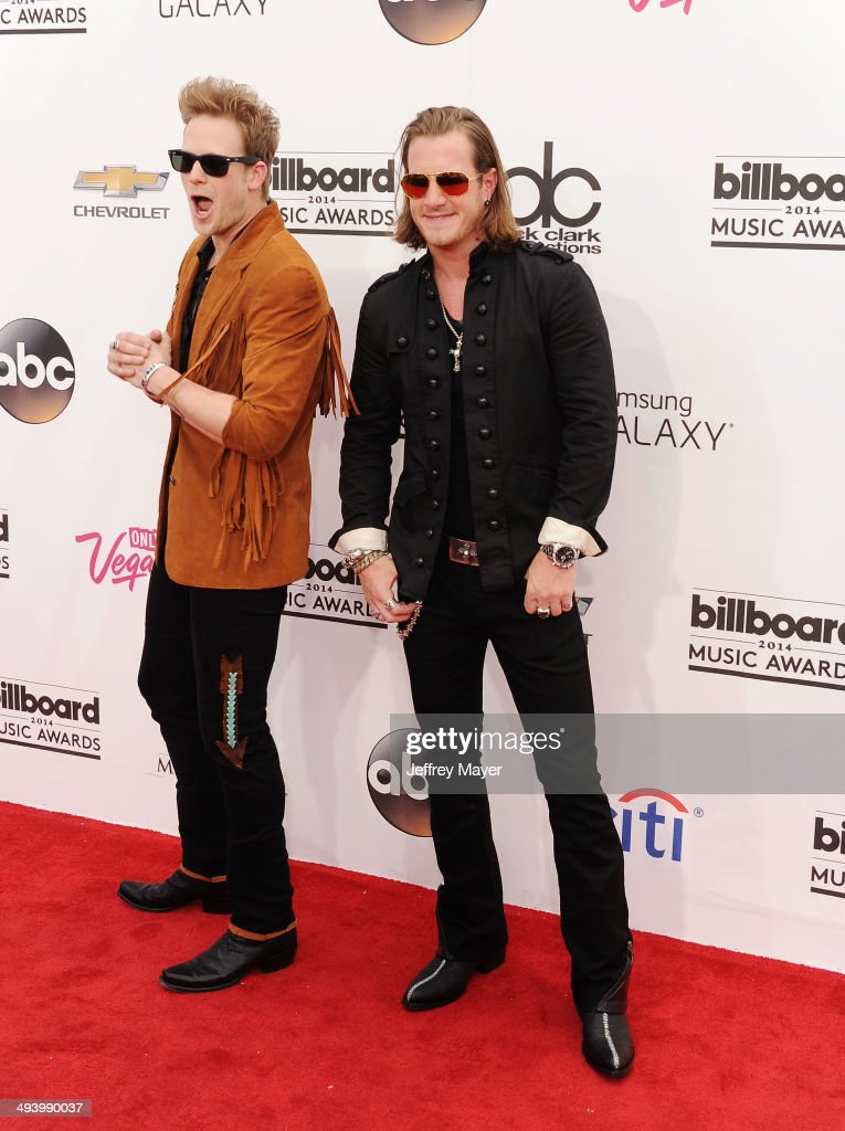 Musicians Brian Kelley and Tyler Hubbard of Florida Georgia Line arrive at the 2014 Billboard Music Awards at the MGM Grand Garden Arena on May 18, 2014 in Las Vegas, Nevada.