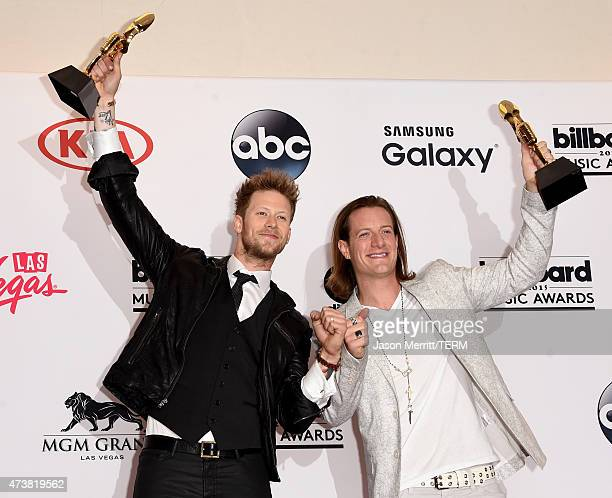 Musicians Brian Kelley and Tyler Hubbard of Florida Georgia Line winners of Top Country Artist pose in the press room during the 2015 Billboard Music...