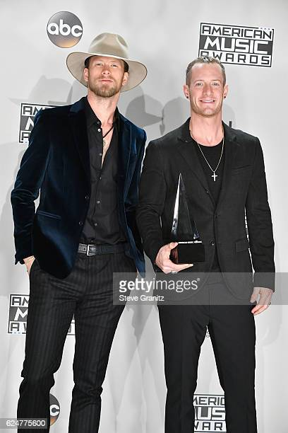 Musicians Brian Kelley and Tyler Hubbard of Florida Georgia Line winners of the Favorite Country Duo or Group award pose in the press room during the...