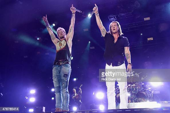 Musicians Brian Kelley and Tyler Hubbard of Florida Georgia Line perform onstage during the 2015 CMA Festival on June 11 2015 in Nashville Tennessee