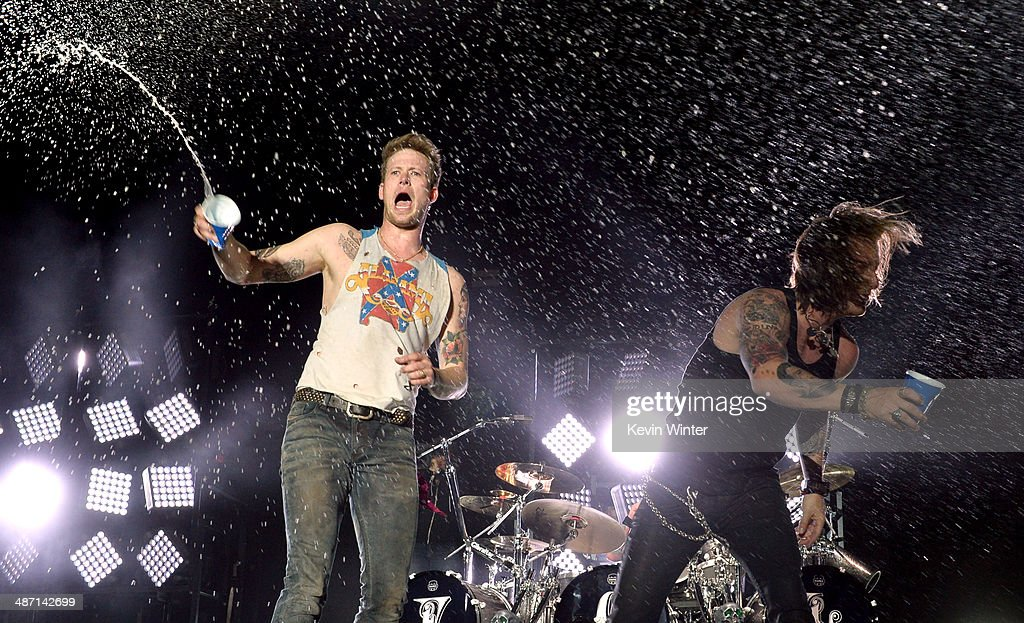 Musicians Brian Kelley and <a gi-track='captionPersonalityLinkClicked' href=/galleries/search?phrase=Tyler+Hubbard&family=editorial&specificpeople=9453787 ng-click='$event.stopPropagation()'>Tyler Hubbard</a> of Florida Georgia Line perform onstage during day 3 of 2014 Stagecoach: California's Country Music Festival at the Empire Polo Club on April 27, 2014 in Indio, California.
