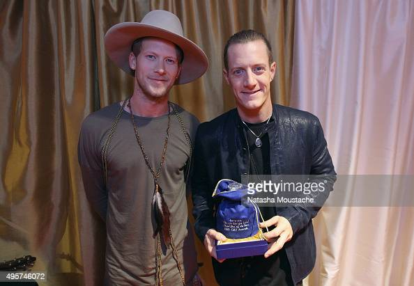 Musicians Brian Kelley and Tyler Hubbard of Florida Georgia Line celebrate their win for Vocal Duo of the Year with a special bottle of Crown Royal...