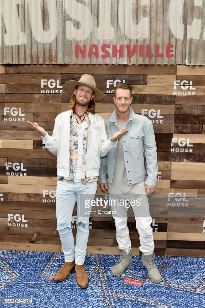Musicians Brian Kelley and Tyler Hubbard of Florida Georgia Line celebrate their grand opening of FGL House on June 5 2017 in Nashville Tennessee