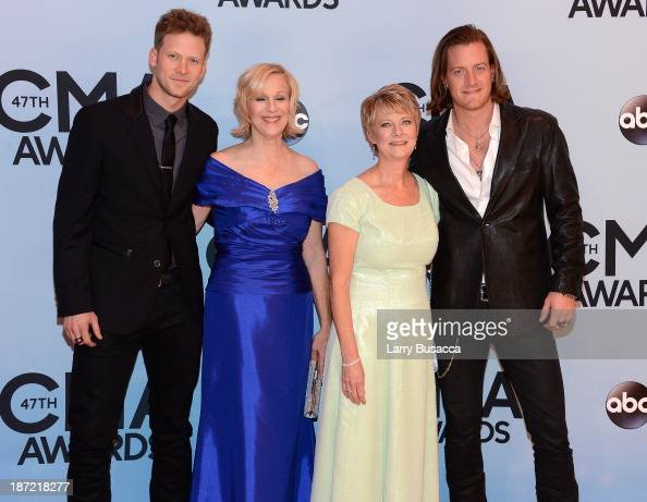 Musicians Brian Kelley and Tyler Hubbard of Florida Georgia Line pose with their mothers attend the 47th annual CMA Awards at the Bridgestone Arena...