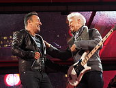 Musicians Bruce Springsteen and Adam Clayton of U2 perform for World AIDS Day Concert at Times Square on December 1 2014 in New York City