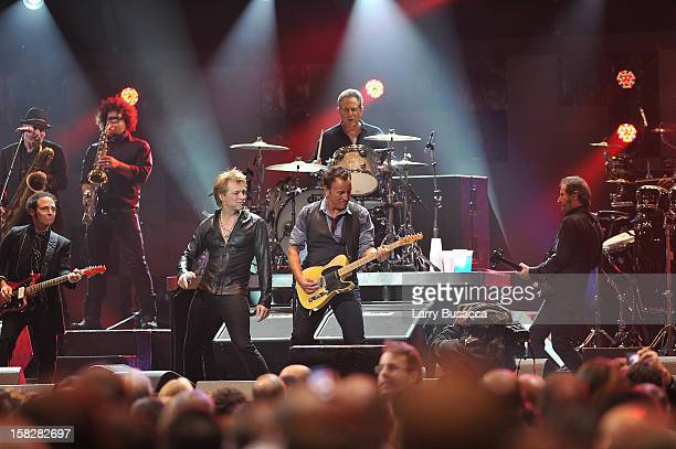 Musicians Bruce Springsteen Jon Bon Jovi and Max Weinberg perform at '121212' a concert benefiting The Robin Hood Relief Fund to aid the victims of...
