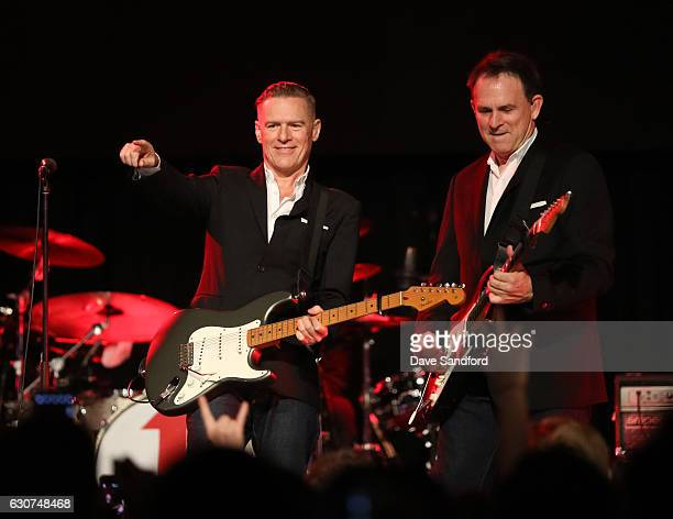 Musicians Bryan Adams and Keith Scott perform during the NHL Centennial Classic New Year's Eve Celebration at Muzik Event Center on December 31 2016...