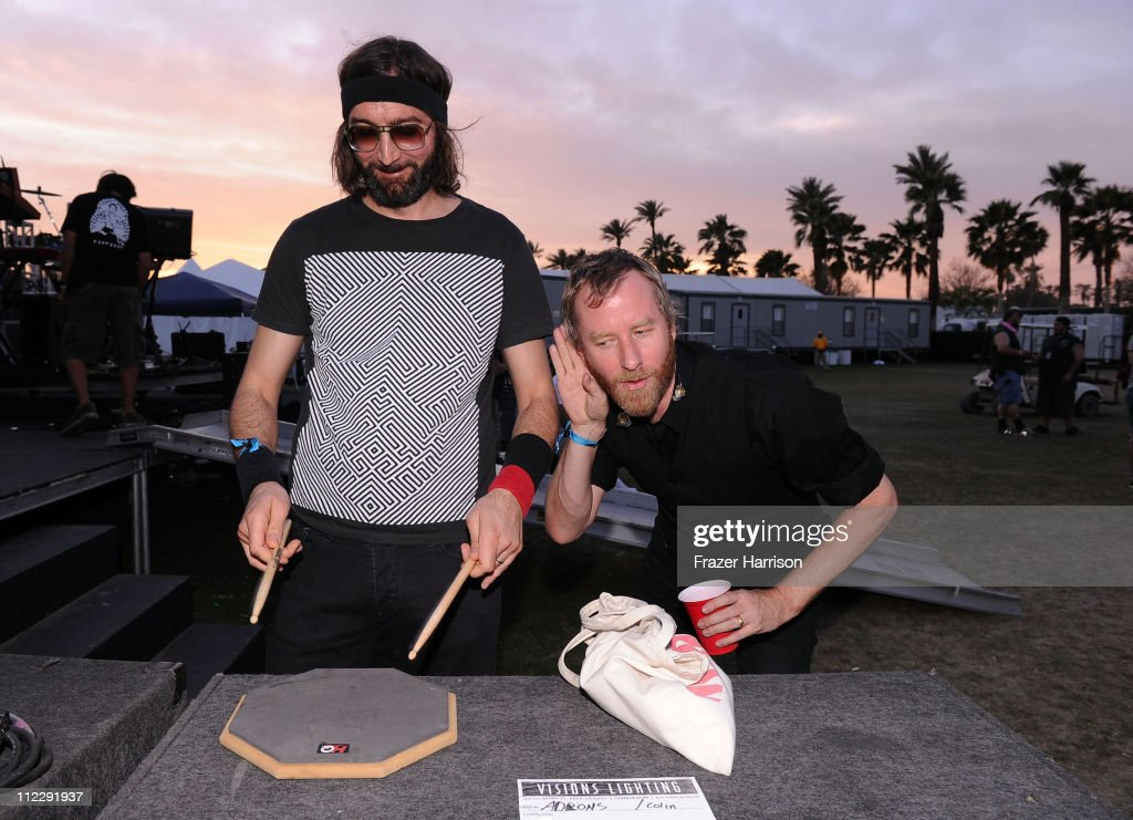 Musicians Bryan Devendorf (L) and Matt Berninger of the band The National backstage during Day 3 of the Coachella Valley Music & Arts Festival 2011 held at the Empire Polo Club on April 17, 2011 in Indio, California.