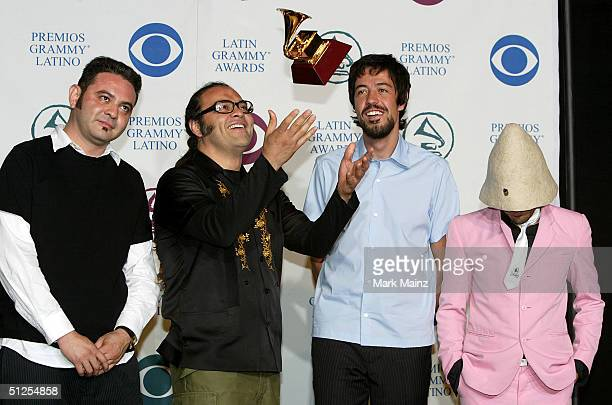 Musicians Cafe Tacuba pose backstage with their award for Best Alternative Music Album for 'Cuatro Caminos' at the '5th Annual Latin Grammy Awards'...
