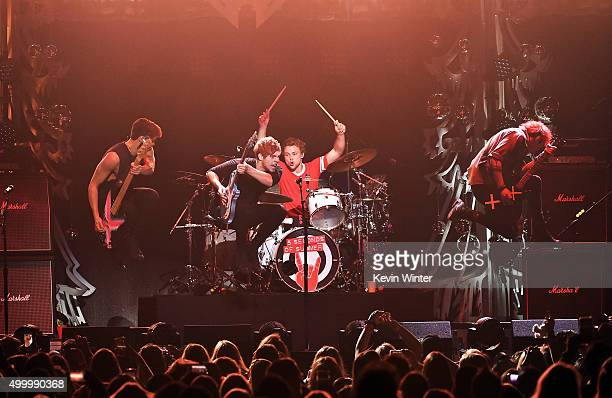 Musicians Calum Hood Luke Hemmings Ashton Irwin and Michael Clifford of 5 Seconds Of Summer perform onstage during 1027 KIIS FM's Jingle Ball 2015...