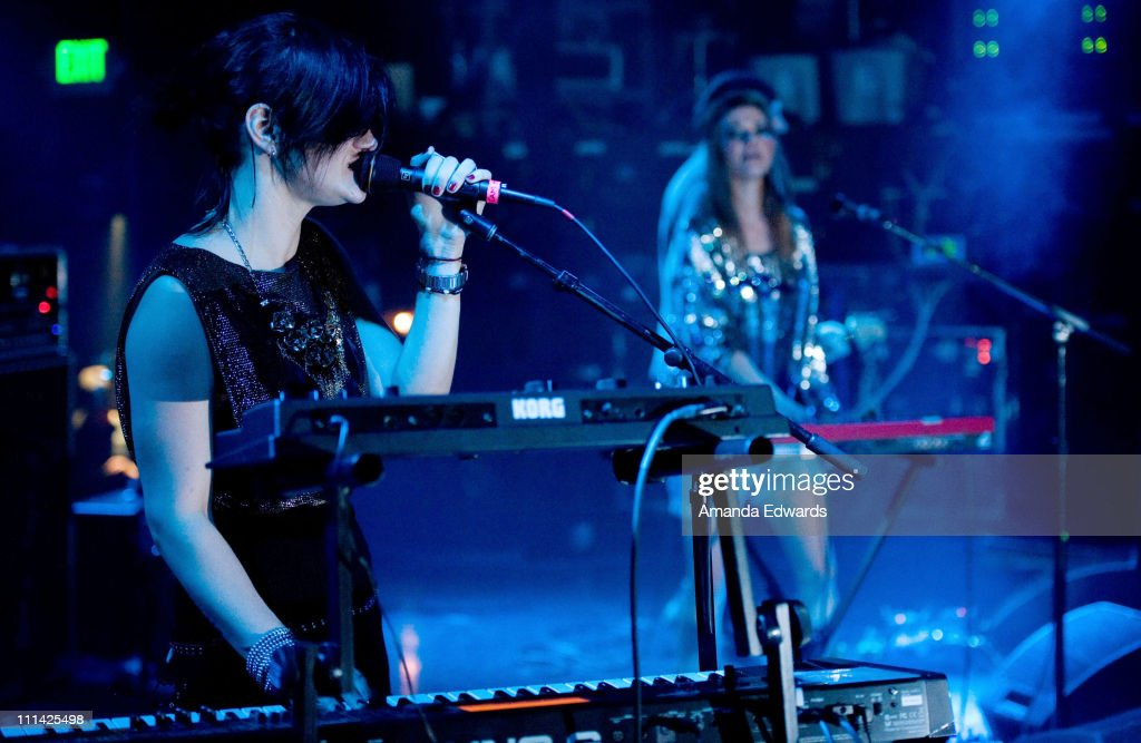 Musicians Camila Grey (L) and <a gi-track='captionPersonalityLinkClicked' href=/galleries/search?phrase=Leisha+Hailey&family=editorial&specificpeople=240479 ng-click='$event.stopPropagation()'>Leisha Hailey</a> of Uh Huh Her perform onstage at The El Rey Theatre on April 1, 2011 in Los Angeles, California.