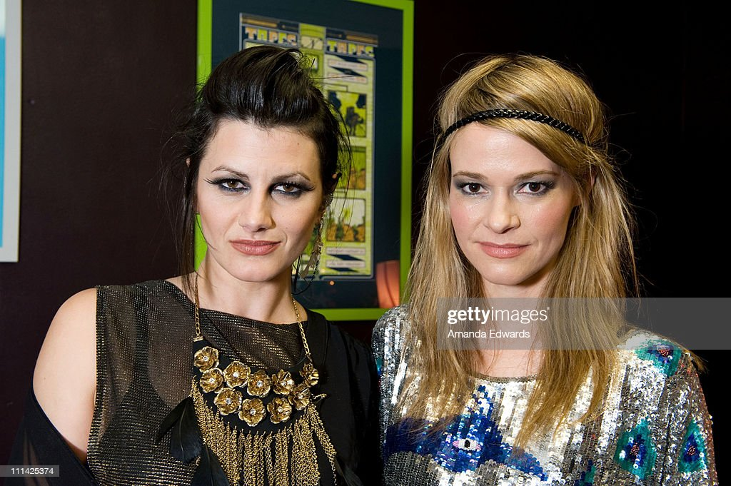 Musicians Camila Grey (L) and Leisha Hailey of Uh Huh Her pose backstage before their performance at The El Rey Theatre on April 1, 2011 in Los Angeles, California.