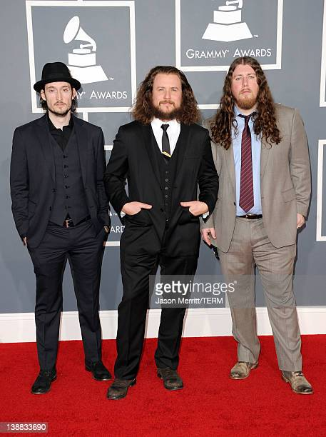 Musicians Carl Broemel Jim James and Patrick Hallahan of the band My Morning Jacket arrive at the 54th Annual GRAMMY Awards held at Staples Center on...