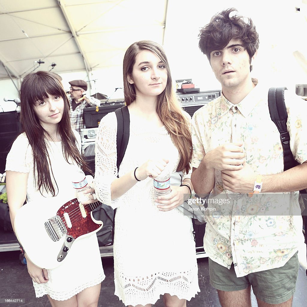 Musicians Carlee Hendrix, Alyssa Midcalf and Ignacio Caniza of You Me & Us pose backstage during day 1 of the 2013 Coachella Valley Music & Arts Festival at the Empire Polo Club on April 12, 2013 in Indio, California.