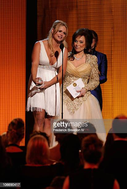Musicians Carrie Underwood and Loretta Lynn speak onstage at the 44th Annual CMA Awards at the Bridgestone Arena on November 10 2010 in Nashville...