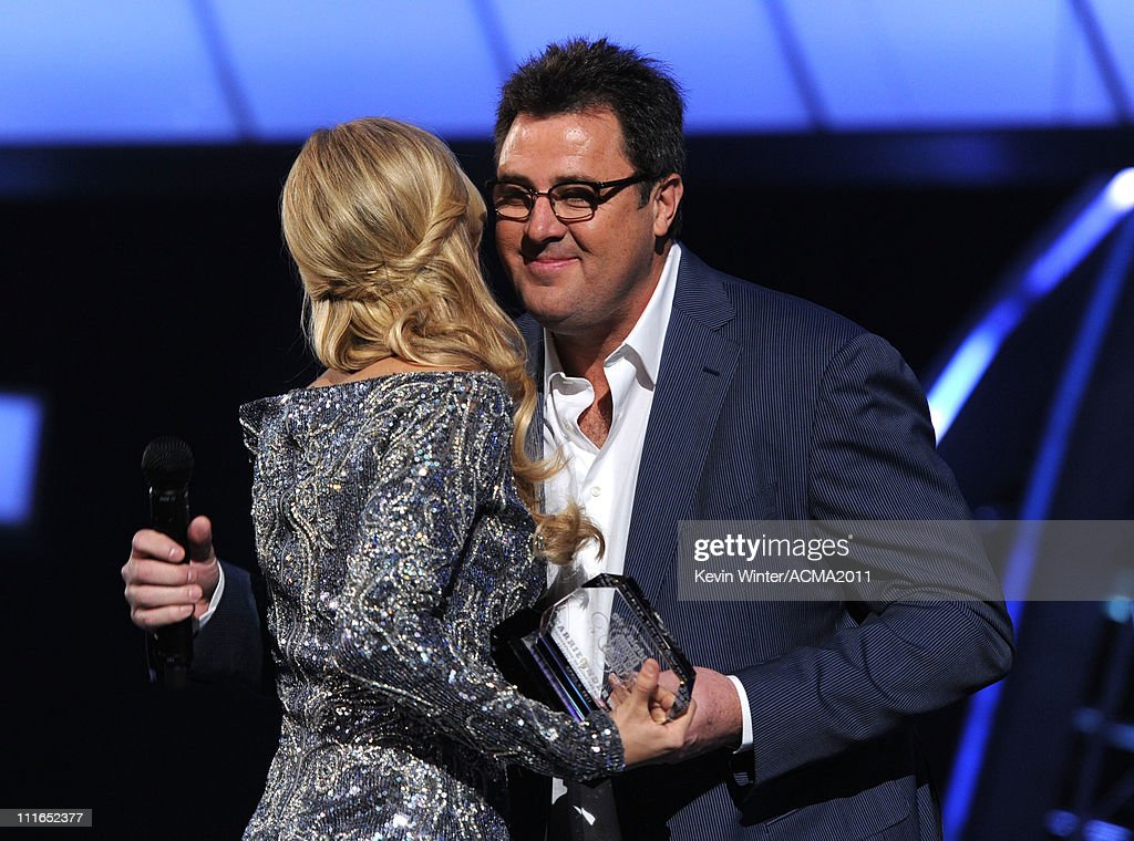 Musicians Carrie Underwood and Vince Gill onstage during ACM Presents: Girls' Night Out: Superstar Women of Country concert held at the MGM Grand Garden Arena on April 4, 2011 in Las Vegas, Nevada.