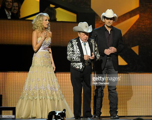 Musicians Carrie Underwood Little Jimmyy Dickens and Brad Paisley perform onstage during the 43rd Annual CMA Awards at the Sommet Center on November...