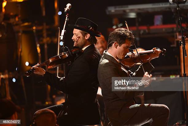 Musicians Chance McCoy and Ketch Secor of Old Crow Medicine Show perform onstage at the Premiere Ceremony during The 57th Annual GRAMMY Awards at the...