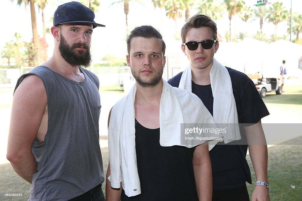 Musicians Charles Cave Harry McVeigh and Jack LawrenceBrown of White Lies pose onstage during day 2 of the 2014 Coachella Valley Music Arts Festival...