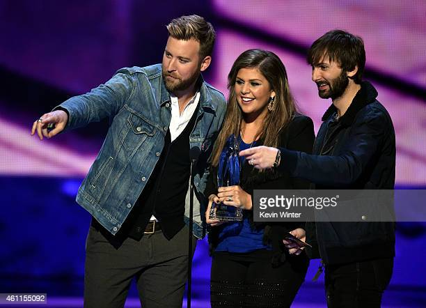 Musicians Charles Kelley Hilary Scott and Dave Haywood of Lady Antebellum accept the Favorite Country Group award onstage at The 41st Annual People's...