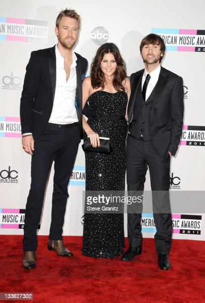 Musicians Charles Kelley Hillary Scott and Dave Haywood of Lady Antebellum arrive at the 2011 American Music Awards held at Nokia Theatre LA LIVE on...