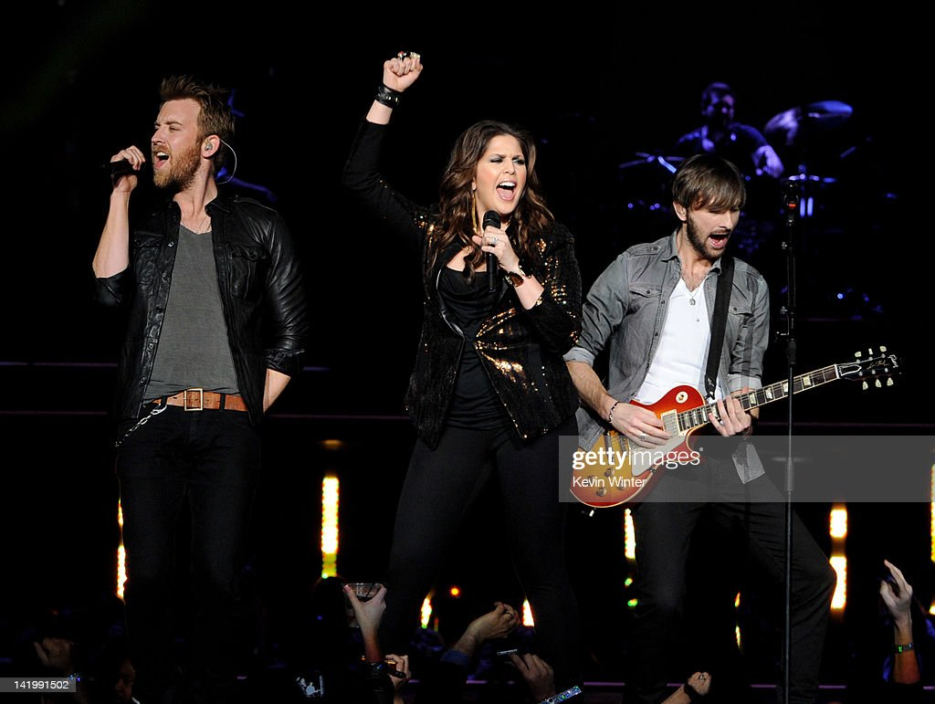 Musicians <a gi-track='captionPersonalityLinkClicked' href=/galleries/search?phrase=Charles+Kelley&family=editorial&specificpeople=3935435 ng-click='$event.stopPropagation()'>Charles Kelley</a>, Hillary Scott and <a gi-track='captionPersonalityLinkClicked' href=/galleries/search?phrase=Dave+Haywood&family=editorial&specificpeople=4620526 ng-click='$event.stopPropagation()'>Dave Haywood</a> of Lady Antebellum perform at Staples Center on March 27, 2012 in Los Angeles, California.