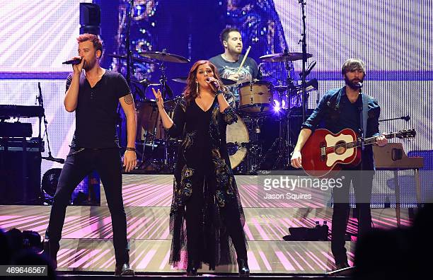 Musicians Charles Kelley Hillary Scott and Dave Haywood of Lady Antebellum perform at Sprint Center on February 15 2014 in Kansas City Missouri