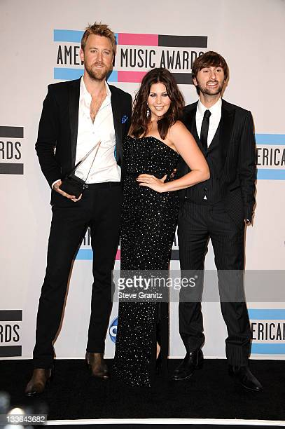 Musicians Charles Kelley Hillary Scott and Dave Haywood of Lady Antebellum poses in the press room at the 2011 American Music Awards held at Nokia...
