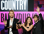 Musicians Charles Kelley Hillary Scott and Dave Haywood of Lady Antebellum accept Country Band Duo or Group award onstage at the 2011 American Music...