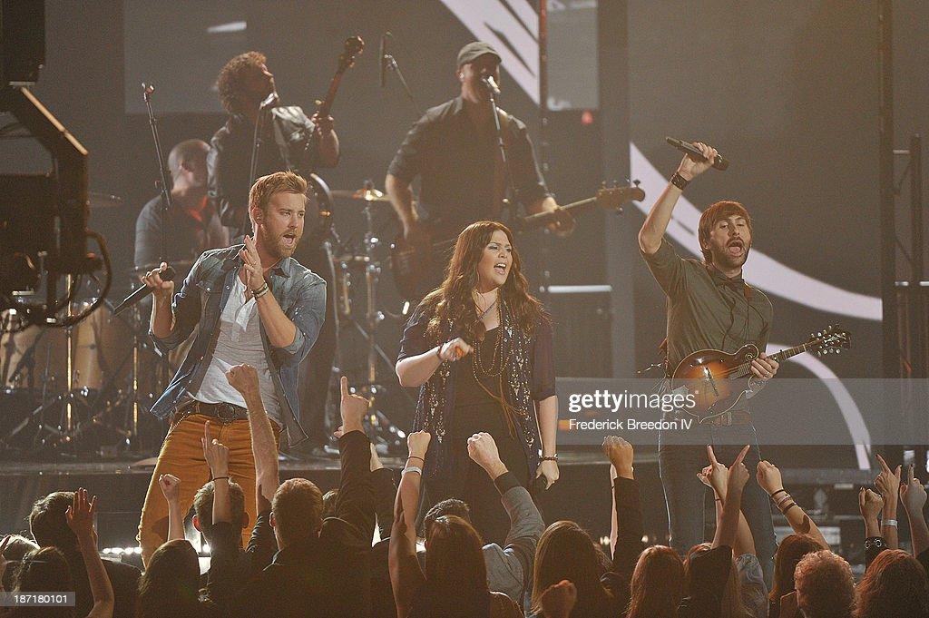 Musicians Charles Kelley, Hillary Scott and Dave Haywood of Lady Antebellum perform during the 47th annual CMA awards at the Bridgestone Arena on November 6, 2013 in Nashville, Tennessee.