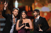 Musicians Charles Kelley Hillary Scott and Dave Haywood of the group Lady Antebellum accept the award for 'Best Country Album' onstage at the 54th...