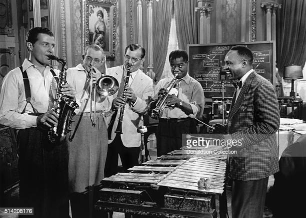 Musicians Charlie Bennett Tommy Dorsey Benny Goodman Louis Armstrong and Lionel Hampton in a scene from the movie 'A Song Is Born which was released...