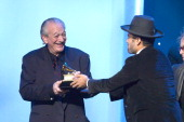 Musicians Charlie Musselwhite and Ben Harper accept the Best Blues Album award for 'Get Up' onstage during the 56th GRAMMY Awards PreTelecast Show at...