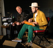 Musicians Charlie Musselwhite and Ben Harper perform during GRAMMY U off The Record with Ben Harper and Charlie Musselwhite at The Recording Academy...