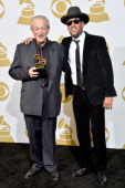 Musicians Charlie Musselwhite and Ben Harper winners of the Best Blues Album award for 'Get Up' pose in the press room during the 56th GRAMMY Awards...
