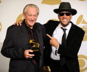 Musicians Charlie Musselwhite and Ben Harper winners of the Best Blues Album award for 'Get Up' pose in the press room at the 56th GRAMMY Awards at...