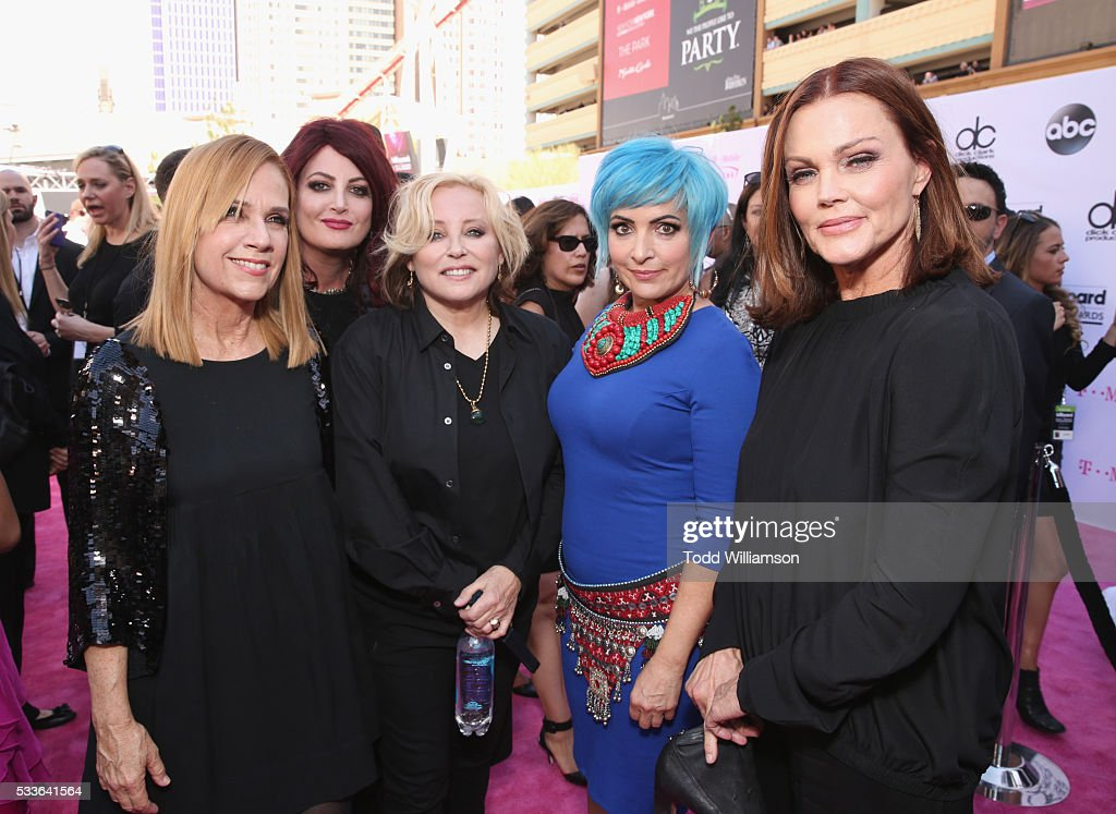 Musicians Charlotte Caffey Abby Travis Gina Schock Jane Wiedlin and Belinda Carlisle of The GoGo's attend the 2016 Billboard Music Awards at TMobile...