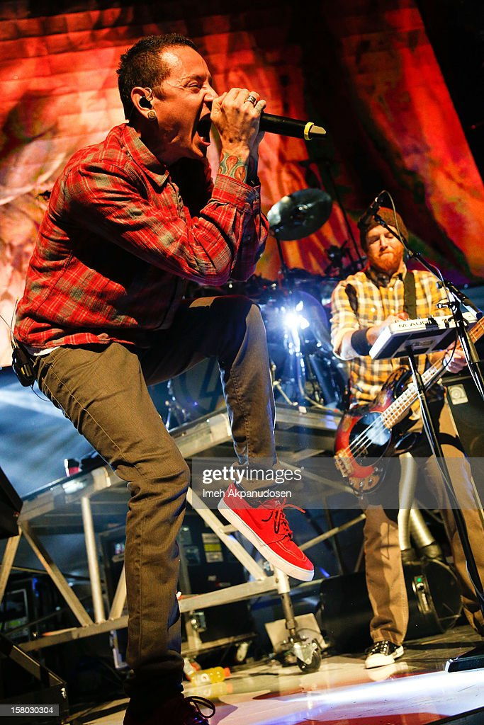 Musicians Chester Bennington (L) and David 'Phoenix' Farrell of Linkin Park perform at the 23rd Annual KROQ Almost Acoustic Christmas at Gibson Amphitheatre on December 8, 2012 in Universal City, California.