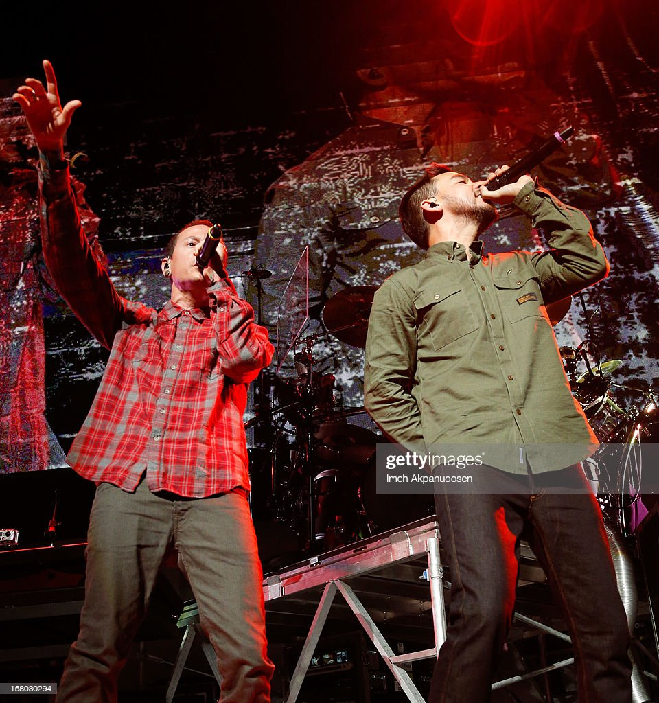 Musicians Chester Bennington (L) and Mike Shinoda of Linkin Park perform at the 23rd Annual KROQ Almost Acoustic Christmas at Gibson Amphitheatre on December 8, 2012 in Universal City, California.