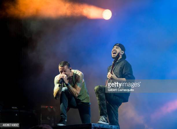 Musicians Chester Bennington and Mike Shinoda of Linkin Park performs during The Carnivores Tour at the Susquehanna Bank Center on August 15 2014 in...