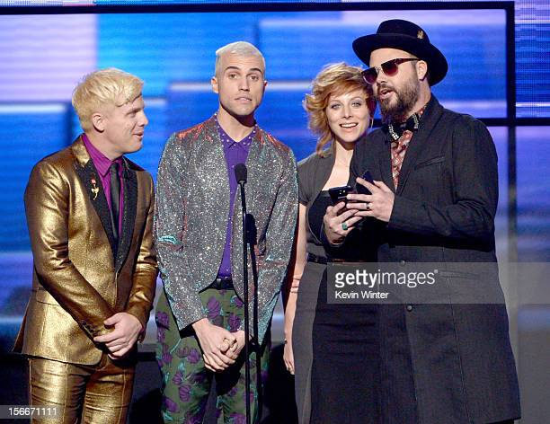 Musicians Chris Allen Tyler Glenn Elaine Bradley and Branden Campbell of Neon Trees speak onstage during the 40th American Music Awards held at Nokia...