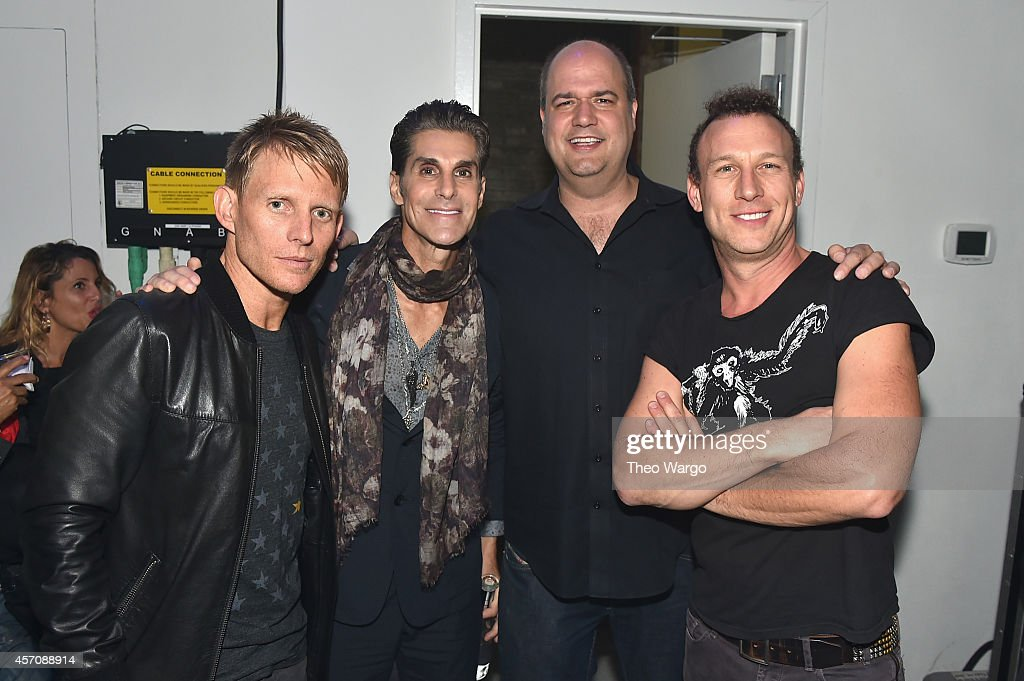 Musicians Chris Cheney Perry Farrell and Stephen Perkins of Jane's Addiction pose backstage with Tim Hayes during the CBGB Music Film Festival 2014...