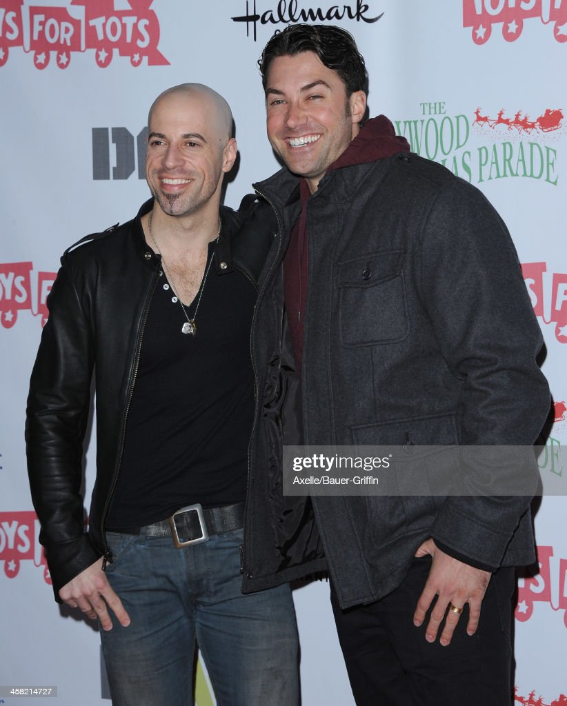 Musicians <a gi-track='captionPersonalityLinkClicked' href=/galleries/search?phrase=Chris+Daughtry&family=editorial&specificpeople=614842 ng-click='$event.stopPropagation()'>Chris Daughtry</a> (L) and <a gi-track='captionPersonalityLinkClicked' href=/galleries/search?phrase=Ace+Young&family=editorial&specificpeople=540262 ng-click='$event.stopPropagation()'>Ace Young</a> attend The Hollywood Christmas Parade Benefiting Toys For Tots Foundation on December 1, 2013 in Hollywood, California.