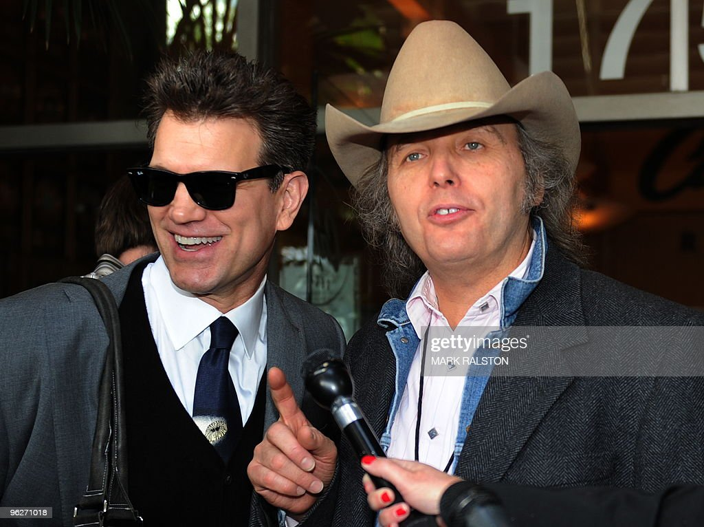 Musicians Chris Isaak (L) and Dwight Yoakam (R) at the ceremony to unveil a Hollywood Walk of Fame star for the late recording artist Roy Orbison in Hollywood on January 29, 2010. AFP PHOTO/Mark RALSTON