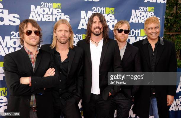 Musicians Chris Shiflett Taylor Hawkins Dave Grohl Nate Mendel and Pat Smear of Foo Fighters arrive at the 2011 MTV Movie Awards at Universal...