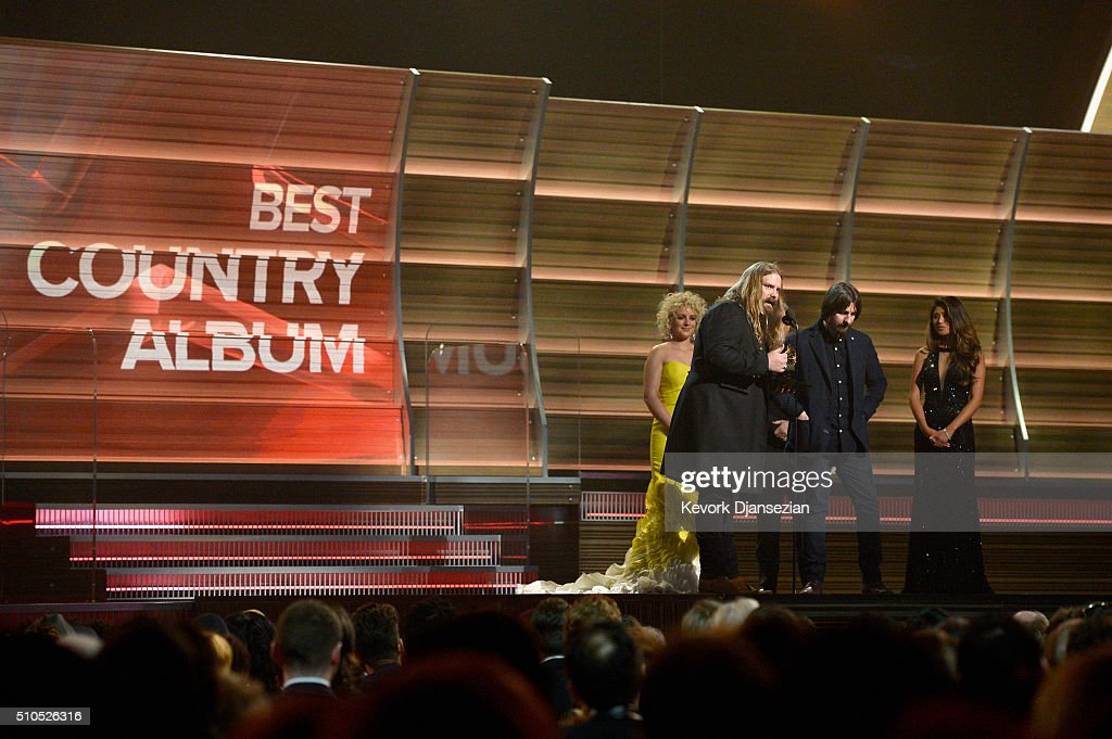 Musicians Chris Stapleton and producer Dave Cobb accept the award for Best Country Album onstage from Actor Gary Sinise (not pictured) and singer Cam during The 58th GRAMMY Awards at Staples Center on February 15, 2016 in Los Angeles, California.